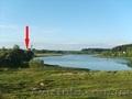 Жилой кирпично-щитовой дом на берегу озера. Беларусь